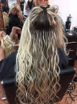 Hairloom - applying blond hair extensions